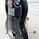 Black Epiphone EB-0 short scale bass side view