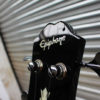 Black Epiphone EB-0 short scale bass side headstock view